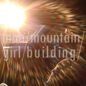 man/mountain/girl/building (single) cover art